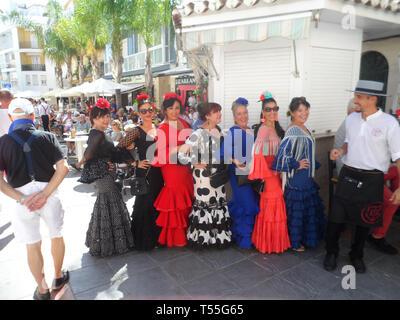 Local Spanish women dressed in traditional flamenco dresses attending the Feria del Rosario. An annual comunity fair in Fuengirola, Costa del sol, - Stock Photo