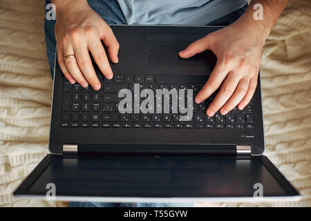 a man works on a laptop, a freelancer develops new goals. - Stock Photo