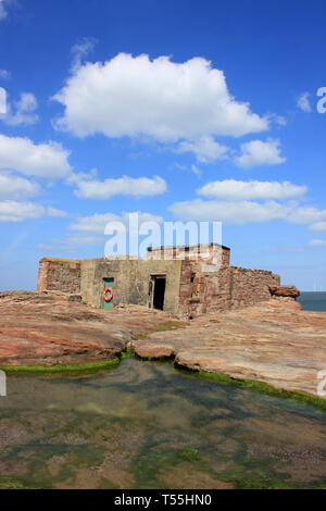 Old Lifeboat House on Hilbre Island, Dee Estuary, Wirral, UK - Stock Photo