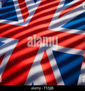 Union Jack with dark stripes. - Stock Photo