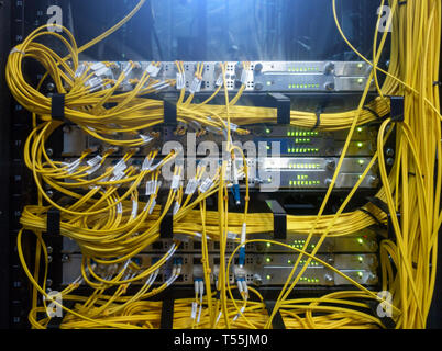 Close up fiber optic cable. Servers racks. Severs computer in a rack at the large data center. - Stock Photo