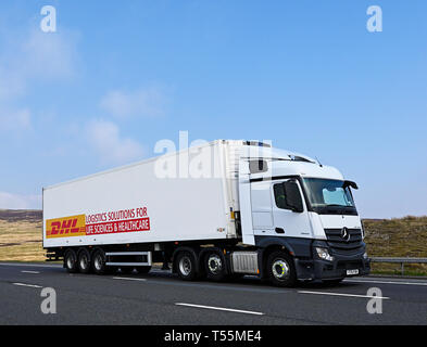 DHL Logistics Solutions for Life Sciences & Healthcare HGV. M6 Motorway, Southbound, Shap, Cumbria, England, United Kingdom, Europe. - Stock Photo