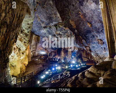 Walking trail through illuminated Paradise Cave, one of the biggest dry caves in the world, in Phong Nha Ke Bang national park, Vietnam, Asia - Stock Photo
