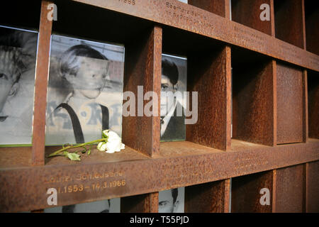 Photographs of people killed while attempting to cross the Berlin Wall, at the Berlin Wall Memorial, Bernauer Strasse, Berlin, Germany. - Stock Photo