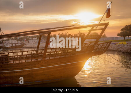 Boat at sunset in Doha, Qatar - Stock Photo