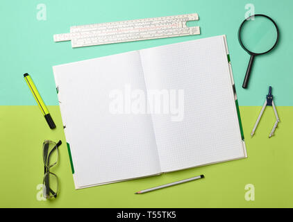 A large notebook for notes and drafting with stationery objects for