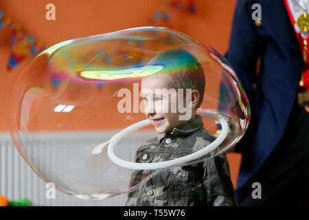 Belarus, the city of Gomel on April 10, 2016, the central children's store.The baby inside the soap bubble. - Stock Photo