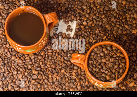 Organic coffee in mugs from Veracruz, Mexico. Black coffee and coffee beans, Mexican produce - Stock Photo