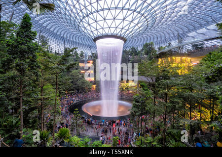 Singapore - April 19: Singapore citizen go to see the amazing indoor waterfall at Jewel in Changi Airport on April 19,2019. - Stock Photo