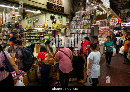 Thailand, Bangkok, Chinatown, Yaowarat, Sampeng Lane market, Soi Wanit 1, shoppers at fancy goods shop - Stock Photo