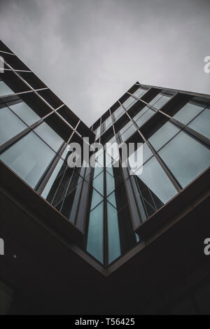 Tall, modern, and glass buildings in Dublin, Ireland. They are located in the financial sector. - Stock Photo