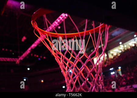 basketball hoop in red neon lights in sports arena during game - competition - Stock Photo