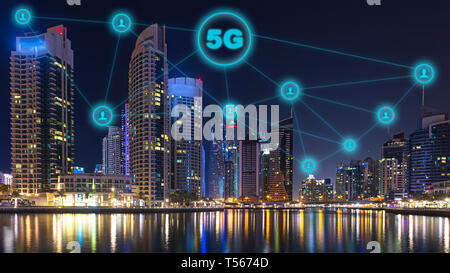 Network connection of future technology with 5g wireless and internet networking sign in night cityscape – communication in smart urban city wireless - Stock Photo