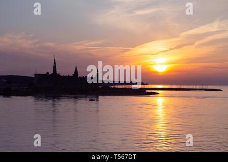 Kronborg castle silhouette in Helsingor at sunset - Stock Photo