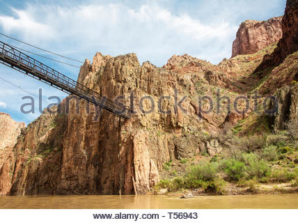 The Kaibab Suspension Bridge crosses the Colorado River in the Grand Canyon basin near Phantom Ranch in Arizona. - Stock Photo