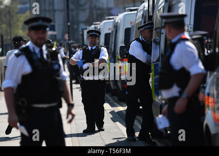 Police prepare to remove Extinction Rebellion demonstrators from Waterloo Bridge in London. - Stock Photo