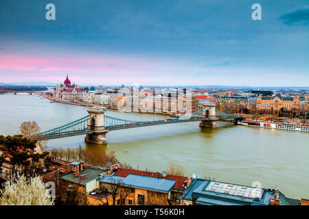 View of Budapest's Parliament and Chain Bridge at dusk - Stock Photo