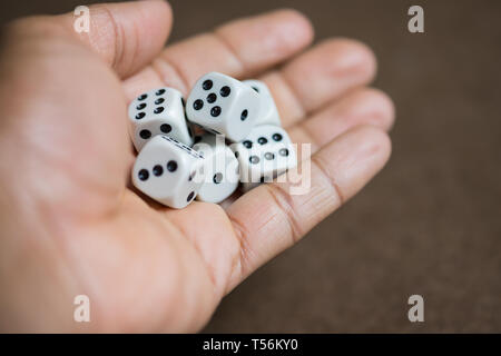 Hand fill with dice, ready to throw dice. - Stock Photo