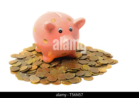 Piggy bank and coins isolated on white - Stock Photo