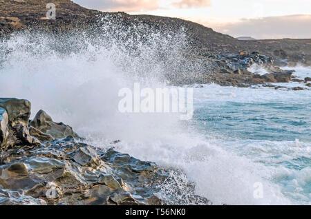 Waves splashing on rocks at shore. - Stock Photo