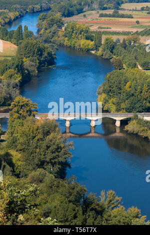 View over the Dordogne river seen from Domme village. The bridge over the river in Domme city. Medieval bridge crossing blue river in Perigord region. - Stock Photo