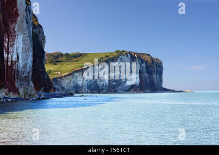 Cliffs at Normandy coast, Les Petites-Dalles, France. Blue beach lagoon with the white chalk cliffs painted by Claude Monet - Stock Photo