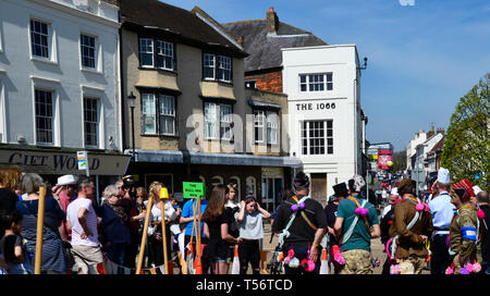 Teams taking part in the annual Good Friday Marbles Competition in fancy dress in Battle Market Square, Battle, East Sussex, UK - Stock Photo