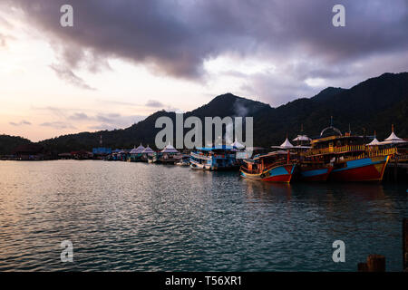 Vivid sunset with a view on a popular fishermen's village Bang Bao at Ko CHang island in Thailand, April, 2018 - Paradise look in reality - Best - Stock Photo