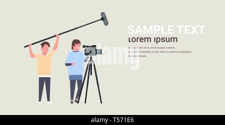 operators using video camera on tripod holding microphone men working with professional equipment recording movie making film production concept - Stock Photo