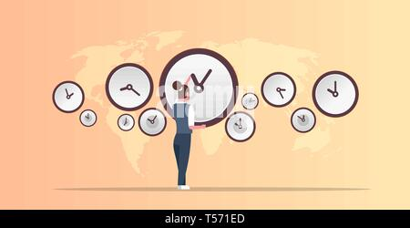 businesswoman pointing on wall with clocks different cities time management deadline concept world map background horizontal full length - Stock Photo