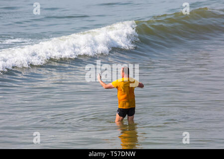 Bournemouth, Dorset, UK. 22nd Apr, 2019. UK weather: after a hazy start the glorious weather continues with hot and sunny weather, as beachgoers head to the seaside to enjoy the heat and sunshine at Bournemouth beaches on Easter Monday before the weather changes and the return to work. Man taking selfies in the sea. Credit: Carolyn Jenkins/Alamy Live News - Stock Photo
