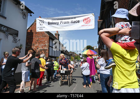 Bolney Sussex, UK. 22nd Apr, 2019. Competitors celebrate finishing the annual Bolney Pram Race in hot sunny weather . The annual races start and finish at the Eight Bells Pub in the village every Easter Bank Holiday Monday Credit: Simon Dack/Alamy Live News - Stock Photo