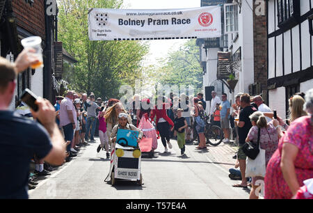 Bolney Sussex, UK. 22nd Apr, 2019. Competitors take part in the annual Bolney Pram Race in hot sunny weather . The annual races start and finish at the Eight Bells Pub in the village every Easter Bank Holiday Monday Credit: Simon Dack/Alamy Live News - Stock Photo