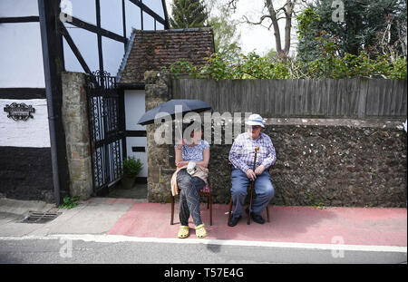 Bolney Sussex, UK. 22nd Apr, 2019. Spetcators stay cool in the shade at the annual Bolney Pram Race in hot sunny weather . The annual races start and finish at the Eight Bells Pub in the village every Easter Bank Holiday Monday Credit: Simon Dack/Alamy Live News - Stock Photo