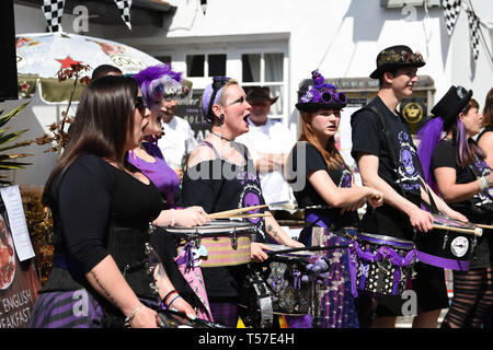 Bolney Sussex, UK. 22nd Apr, 2019. The Stix Drummers entertain the crowd at the annual Bolney Pram Race in hot sunny weather . The annual races start and finish at the Eight Bells Pub in the village every Easter Bank Holiday Monday Credit: Simon Dack/Alamy Live News - Stock Photo