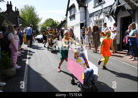 Bolney Sussex, UK. 22nd Apr, 2019. The children's race in the annual Bolney Pram Race in hot sunny weather . The annual races start and finish at the Eight Bells Pub in the village every Easter Bank Holiday Monday Credit: Simon Dack/Alamy Live News - Stock Photo
