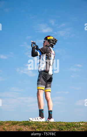 Crosshaven, County Cork, Ireland. 22nd April, 2019. /A cyclist takes a picture of Cork Harbour before setting off at the starting line of the Fort 2 Fort Charity Cycle at Camden Fort Meagher Crosshaven Co. Cork. The cycle is to help raise funds for the Mercy University Hospital Foundation, four Cork City and County Lions Clubs, and Camden Fort Meagher Restoration. Credit: David Creedon/Alamy Live News - Stock Photo