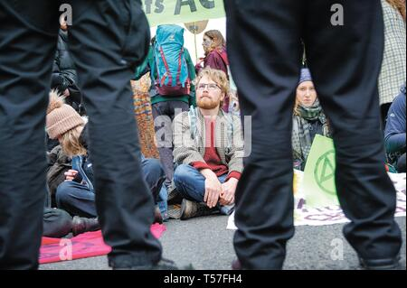 Protesters seen sitting down in the middle of the road during the demonstration. Extinction Rebellion held a lock-down of Edinburgh's North Bridge as part of an international movement. Police Scotland made around 30 arrests over the course of the day as a result. Hundreds of climate change protesters want the Government to declare an emergency over the growing rate of climate change. - Stock Photo