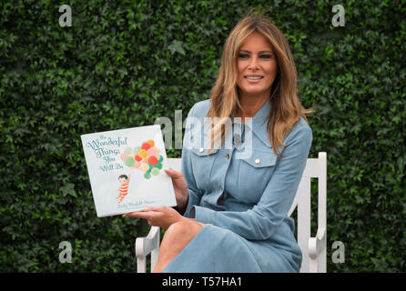 Washington, District of Columbia, USA. 22nd Apr, 2019. First Lady Melania Trump reads a book to children during the White House Easter Egg Roll at the White House in Washington, DC on April 22, 2019 Credit: Kevin Dietsch/CNP/ZUMA Wire/Alamy Live News - Stock Photo
