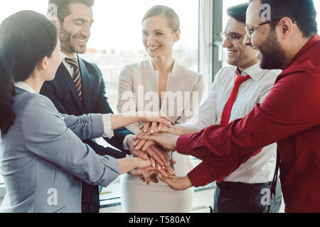 Diversity team of business people in kick-off meeting - Stock Photo