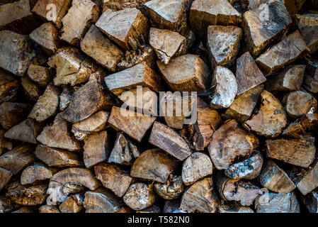 Pile of wood for burining in a wood burner, barbeque, or fire.  Timber log pile - Stock Photo