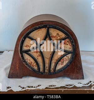 antique intercom used in the kitchens of a historic residence, dark wood radio with light embroidered on the speaker. Square image of vintage object. - Stock Photo