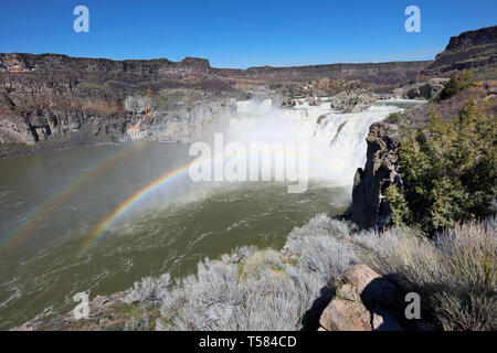 Springtime at Shoshone Falls on the Snake River display beautiful rainbows. - Stock Photo