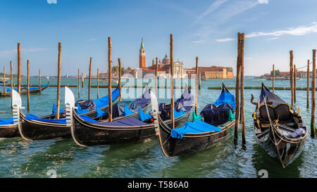 Venice gondolas at sunny day near San Marco square, Venice, Italy. - Stock Photo