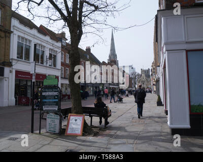 View along busy East Street towards the iconic Cathedral and Market Cross Chichester West Sussex England UK - Stock Photo