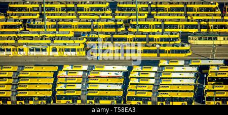 Aerial view, tram depot and bus depot, Essener Verkehrs AG, EVAG, parked vehicles in rows, yellow trams, yellow buses, Essen, North Rhine-Westphalia - Stock Photo