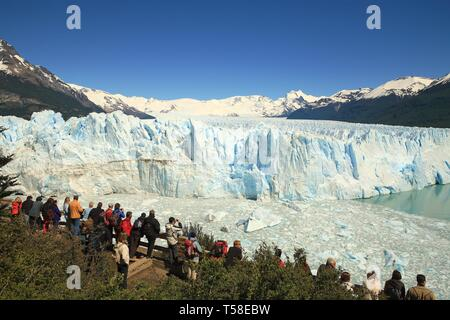 Tourists at the viewpoint on the ice field of the Perito Moreno Glacier, Santa Cruz Province, Patagonia, Argentina - Stock Photo