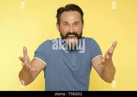 What are you doing. Stop annoying him. Overwhelmed with emotions. Handsome shouting mature man screaming standing against yellow background. Man beard - Stock Photo