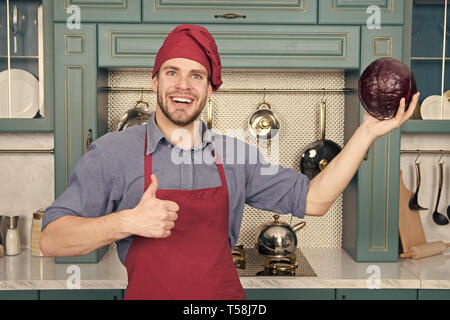 Cook in good mood. Relax put on some music. Composed cook is more efficient one. Man chef likes to cook in relaxing atmosphere. Guy professional chef feels relaxed and cheerful white cooking. - Stock Photo