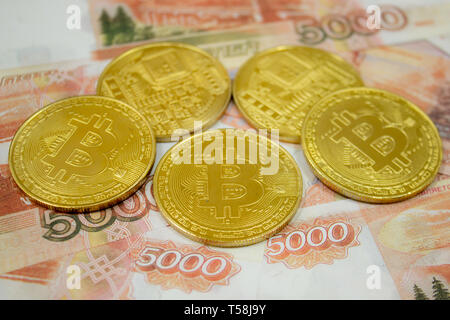 Close-up of Bitcoin coins on 5000 Russian rubles banknote. Crypto currency BTC. - Stock Photo